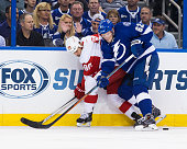 Andrej Sustr of the Tampa Bay Lightning against Stephen Weiss the Detroit Red Wings during the first period in Game One of the Eastern Conference...