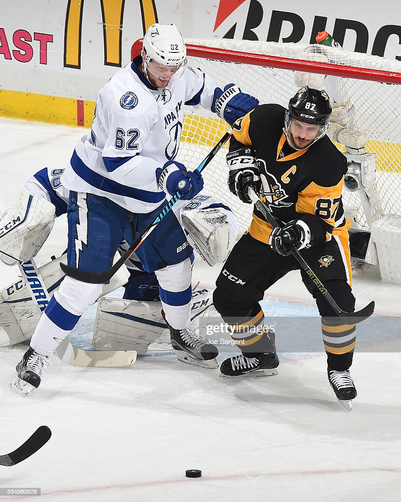 Andrej Sustr #62 of the Tampa Bay Lightning and <a gi-track='captionPersonalityLinkClicked' href=/galleries/search?phrase=Sidney+Crosby&family=editorial&specificpeople=212781 ng-click='$event.stopPropagation()'>Sidney Crosby</a> #87 of the Pittsburgh Penguins skate for the loose puck in Game Seven of the Eastern Conference Final during the 2016 NHL Stanley Cup Playoffs at Consol Energy Center on May 26, 2016 in Pittsburgh, Pennsylvania.