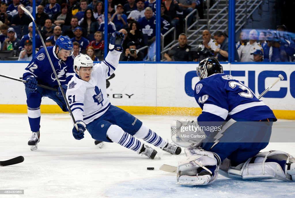 Andrej Sustr #62 of the Tampa Bay Lightning checks <a gi-track='captionPersonalityLinkClicked' href=/galleries/search?phrase=Jake+Gardiner&family=editorial&specificpeople=4884939 ng-click='$event.stopPropagation()'>Jake Gardiner</a> #51 of the Toronto Maple Leafs in front of goalie <a gi-track='captionPersonalityLinkClicked' href=/galleries/search?phrase=Ben+Bishop&family=editorial&specificpeople=700137 ng-click='$event.stopPropagation()'>Ben Bishop</a> #30 at the Tampa Bay Times Forum on April 8, 2014 in Tampa, Florida.