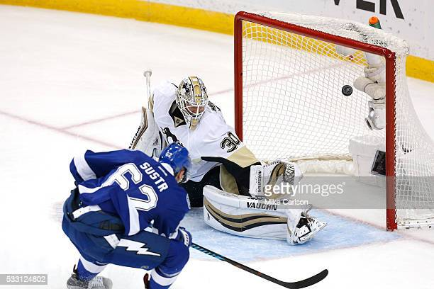 Andrej Sustr of the Tampa Bay Lightning scores a goal against Matt Murray of the Pittsburgh Penguins during the first period in Game Four of the...
