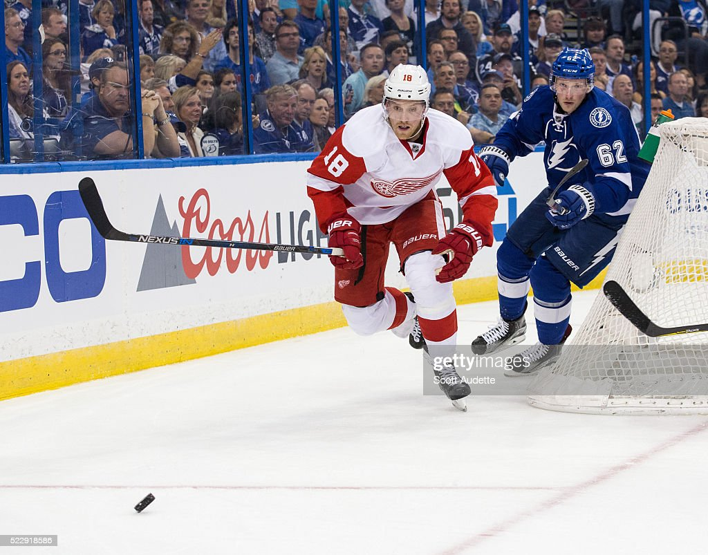 Andrej Sustr of the Tampa Bay Lightning skates against Joakim Andersson of the Detroit Red Wings during the second period of Game One of the Eastern...