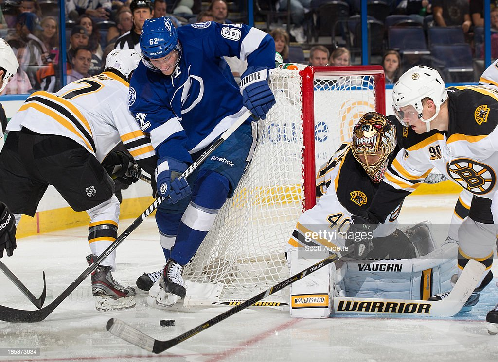 Andrej Sustr #62 of the Tampa Bay Lightning tries to control the puck against Carl Soderberg #34 and goalie <a gi-track='captionPersonalityLinkClicked' href=/galleries/search?phrase=Tuukka+Rask&family=editorial&specificpeople=716723 ng-click='$event.stopPropagation()'>Tuukka Rask</a> #40 of the Boston Bruins during the third period at the Tampa Bay Times Forum on October 19, 2013 in Tampa, Florida.