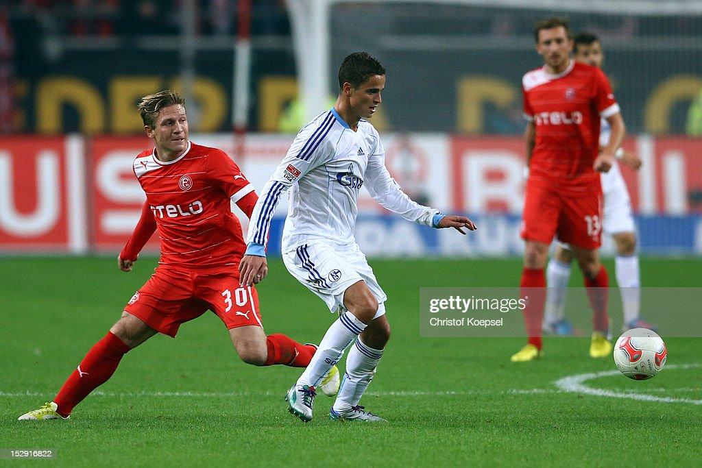 Andrej Voronin of Dues seldorf challenges Ibrahim Affelay of Schalke during the Bundesliga match between Fortuna Duesseldorf and FC Schalke 04 at...