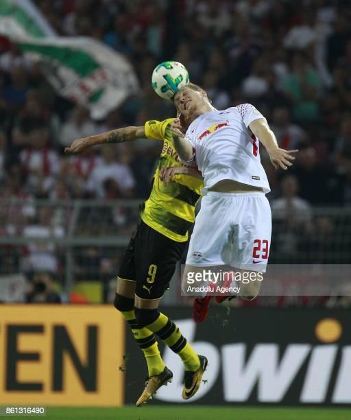 Andrej Yarmolenko of Borussia Dortmund in action against Marcel Halstenberg of Rasenballsport Leipzig during the Bundesliga soccer match between...