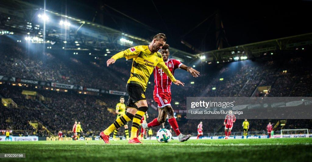 Andrej Yarmolenko (L) of Dortmund and Kingsley Coman (R) of Munich in action during the Bundesliga match between Borussia Dortmund and FC Bayern Muenchen at Signal Iduna Park on November 4, 2017 in Dortmund, Germany.