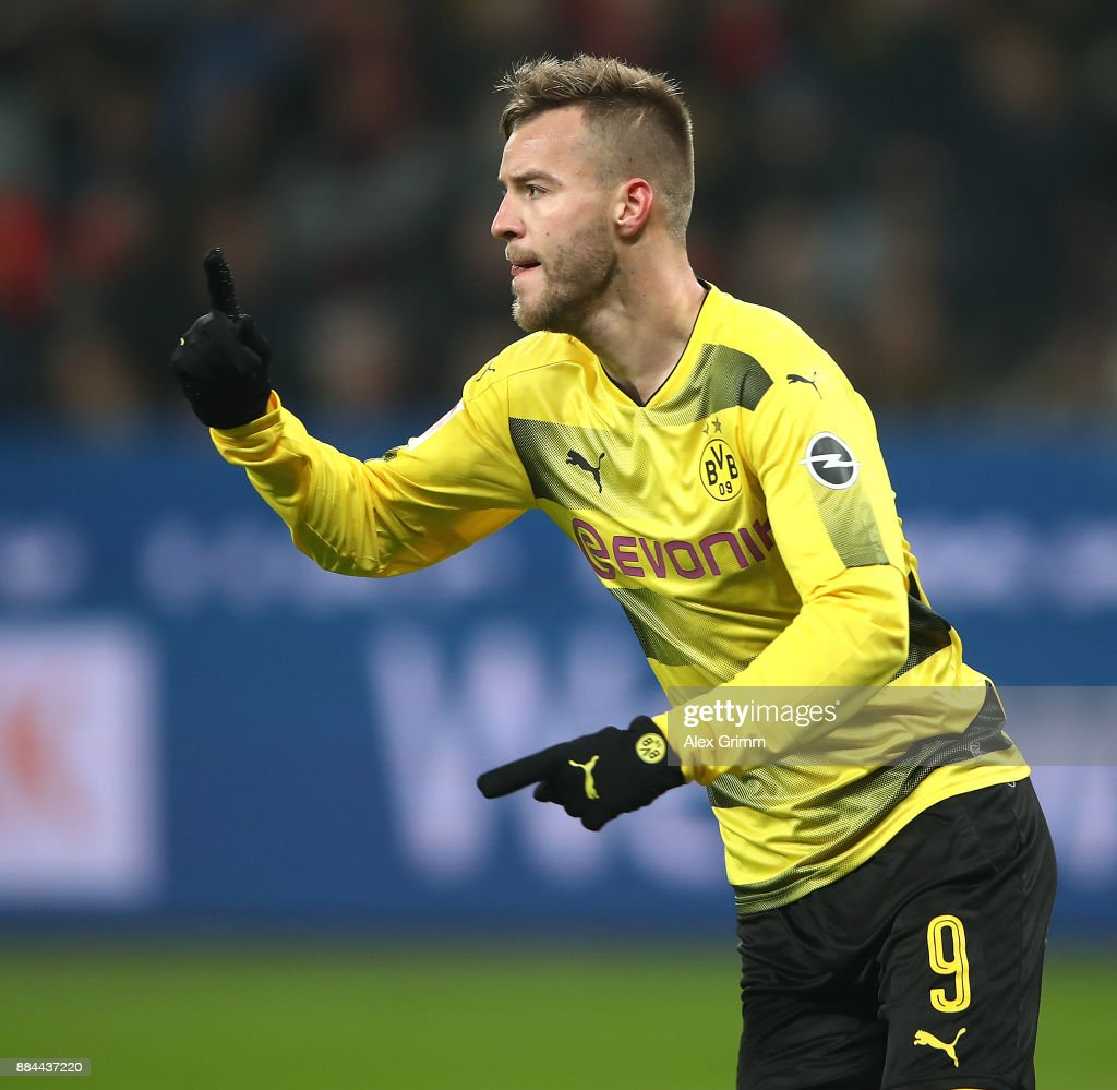 Andrej Yarmolenko of Dortmund (r) celebrates after he scored a goal to make it 1:1 during the Bundesliga match between Bayer 04 Leverkusen and Borussia Dortmund at BayArena on December 2, 2017 in Leverkusen, Germany.