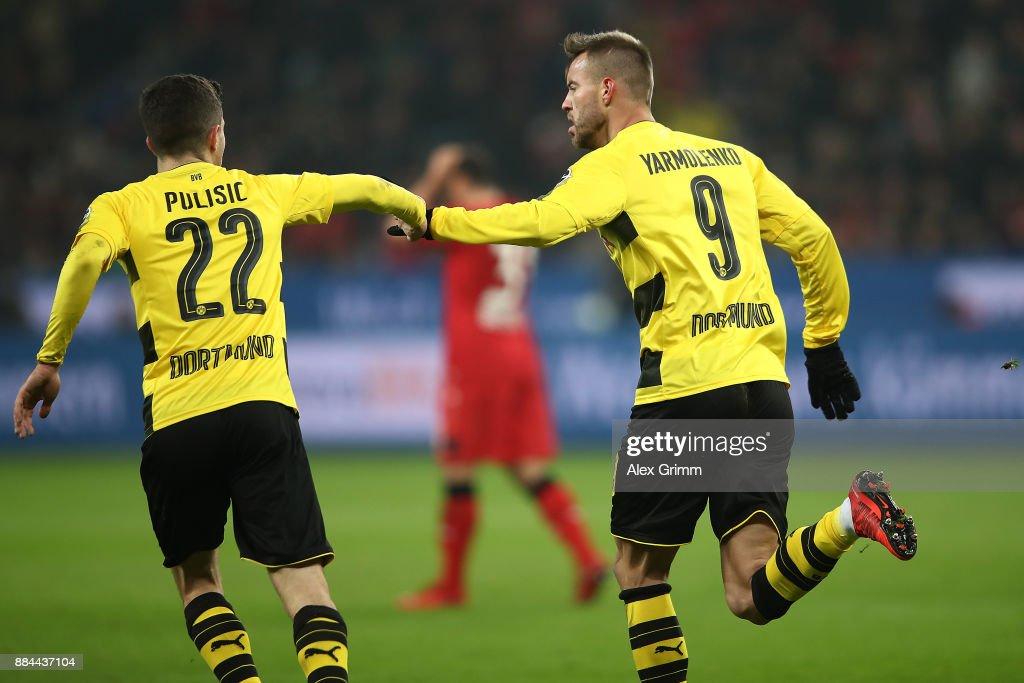 Andrej Yarmolenko of Dortmund (r) celebrates with Christian Pulisic of Dortmund after he scored a goal to make it 1:1 during the Bundesliga match between Bayer 04 Leverkusen and Borussia Dortmund at BayArena on December 2, 2017 in Leverkusen, Germany.