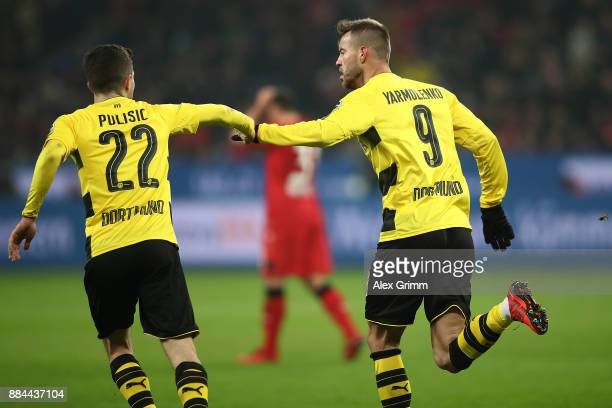 Andrej Yarmolenko of Dortmund celebrates with Christian Pulisic of Dortmund after he scored a goal to make it 11 during the Bundesliga match between...