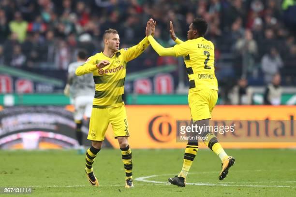 Andrej Yarmolenko of Dortmund celebrates with DanAxel Zagadou of Dortmund after he scored his teams second goal to make it 22 during the Bundesliga...