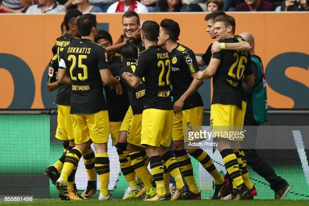 Andrej Yarmolenko of Dortmund celebrates with his team after he scored their first goal to make it 11 during the Bundesliga match between FC Augsburg...
