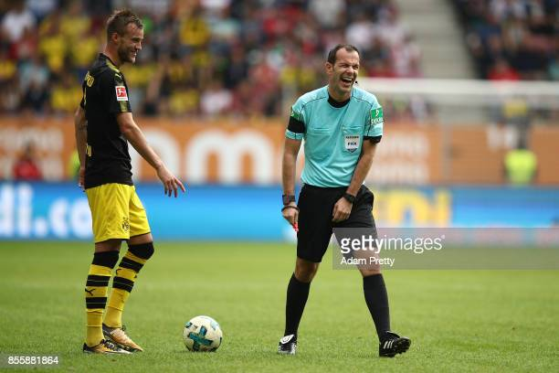 Andrej Yarmolenko of Dortmund has a laugh with referee Marco Fritz during the Bundesliga match between FC Augsburg and Borussia Dortmund at WWKArena...