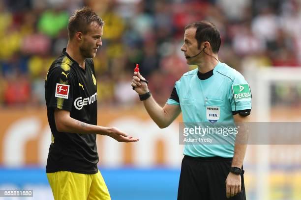 Andrej Yarmolenko of Dortmund talks to referee Marco Fritz during the Bundesliga match between FC Augsburg and Borussia Dortmund at WWKArena on...