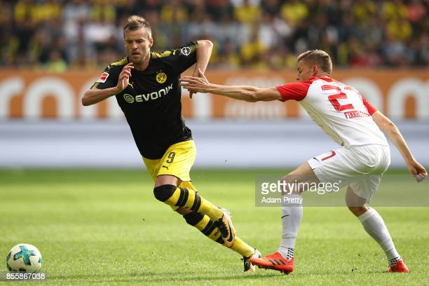 Andrej Yarmolenko of Dortmund with Alfreo Finnbogason of Augsburg during the Bundesliga match between FC Augsburg and Borussia Dortmund at WWKArena...