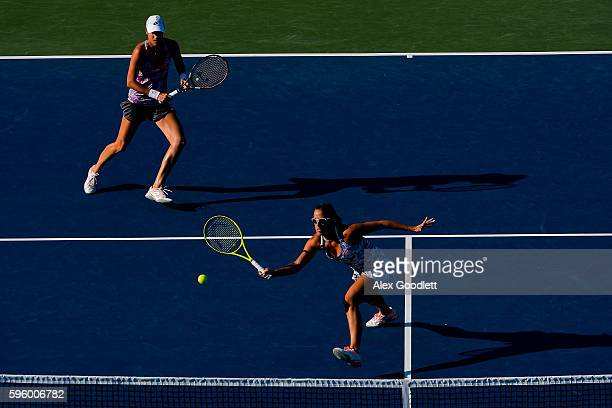 Andreja Klepac of Slovenia and Katarina Srebotnik of Slovenia take on Sania Mirza of India and Monica Niculescu of Romania on day 6 of the...