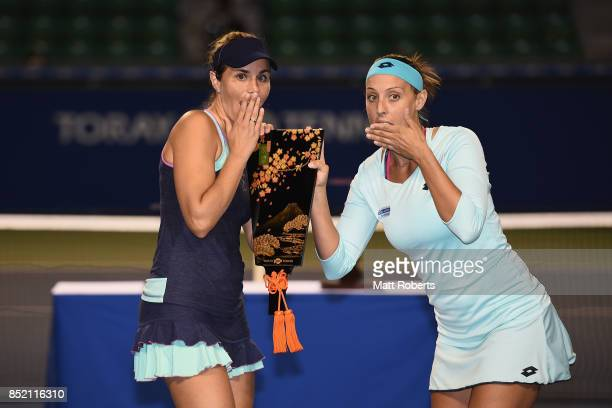 Andreja Klepac of Slovenia and Maria Jose Martinez of Spain pose with the winner trophy after defeating Daria Gavrilova of Australia and Daria...