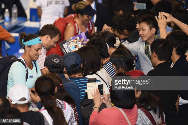 Andreja Klepac of Slovenia and Maria Jose Martinez of Spain sign autographs for fans after defeating Daria Gavrilova of Australia and Daria Kasatkina...