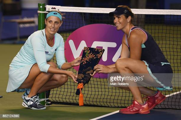 Andreja Klepac of Slovenia and Maria Jose Martinez Sanchez of Spain pose with the winners trophy after defeating Daria Gavrilova of Australia and...