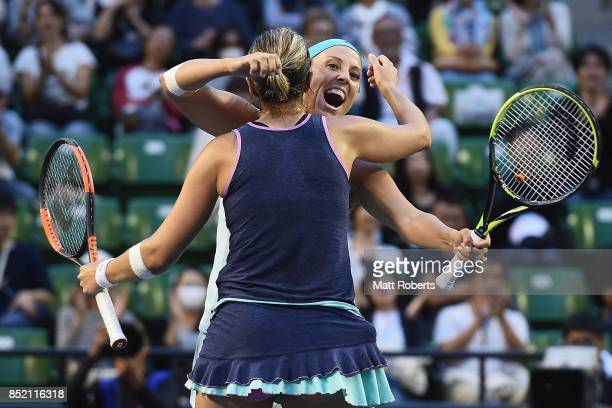 Andreja Klepac of Slovenia celebrates winning with doubles partner Maria Jose Martinez of Spain after defeating Daria Gavrilova of Australia and...
