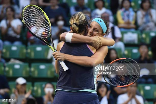 Andreja Klepac of Slovenia celebrates winning with doubles partner Maria Jose Martinez Sanchez of Spain after defeating Daria Gavrilova of Australia...