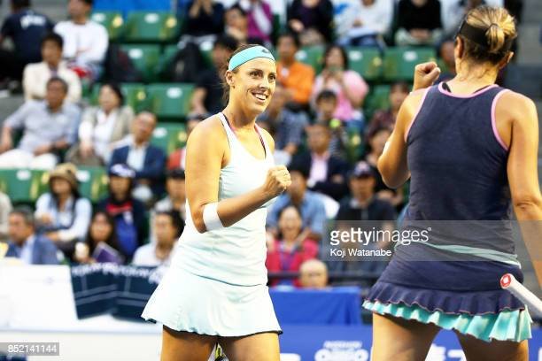Andreja Klepac of Slovenia celebrates with doubles partner Maria Jose Martinez of Spain after defeating Daria Gavrilova of Australia and Daria...