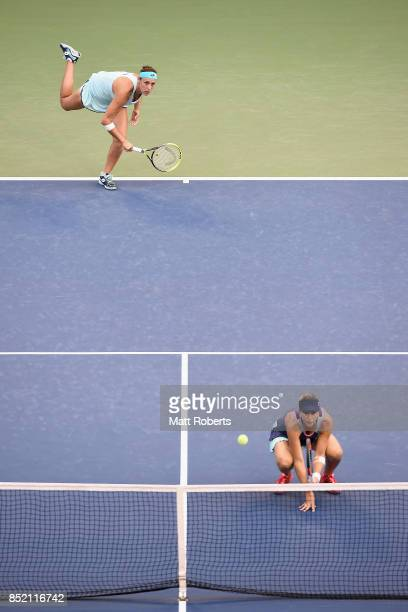 Andreja Klepac of Slovenia serves with her doubles partner Maria Jose Martinez of Spain against Daria Gavrilova of Australia and Daria Kasatkina of...