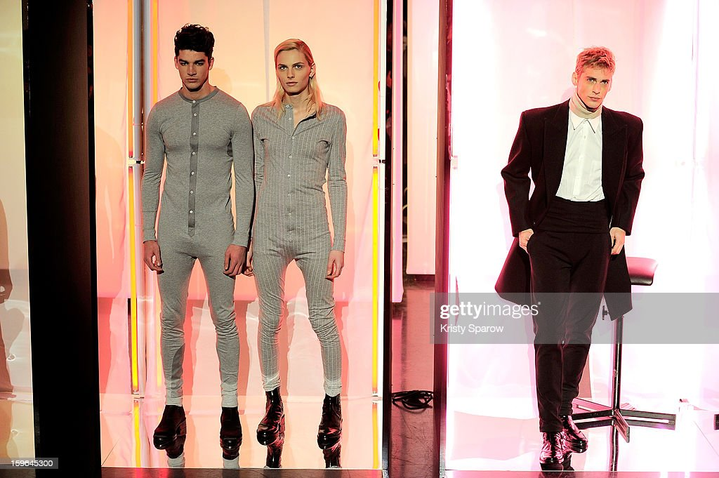 Andrej Pejic (C) and models pose during the Jean Paul Gaultier Menswear Autumn / Winter 2013/14 show as part of Paris Fashion Week on January 17, 2013 in Paris, France.