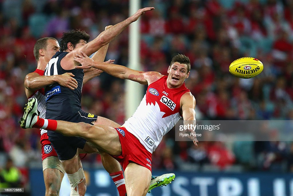 Andrejs Everitt of the Swans competes for the ball against <a gi-track='captionPersonalityLinkClicked' href=/galleries/search?phrase=Jarrad+Waite&family=editorial&specificpeople=224526 ng-click='$event.stopPropagation()'>Jarrad Waite</a> of the Blues during the AFL First Semi Final match between the Sydney Swans and the Carlton Blues at ANZ Stadium on September 14, 2013 in Sydney, Australia.