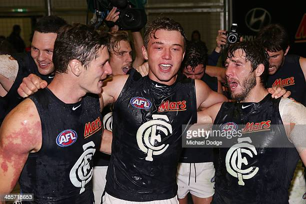 Andrejs Everitt Patrick Cripps and Dale Thomas celebrate their win during the round five AFL match between the Western Bulldogs and the Carlton Blues...