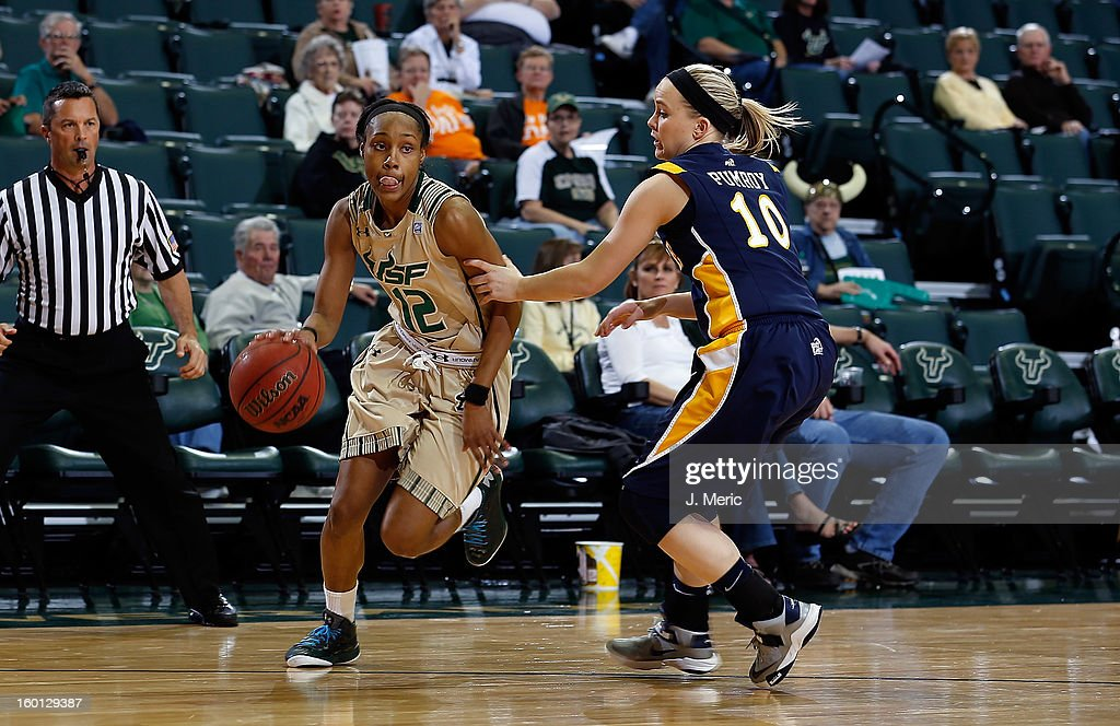 Andrell Smith #12 of the South Florida Bulls drives as Brooklyn Pumroy #10 of the Marquette Golden Eagles defends during the game at the Sun Dome on January 26, 2013 in Tampa, Florida.