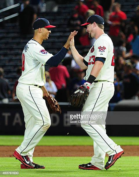 Andrelton Simmons and Chris Johnson of the Atlanta Braves celebrate after the game against the Oakland Athletics at Turner Field on August 17 2014 in...