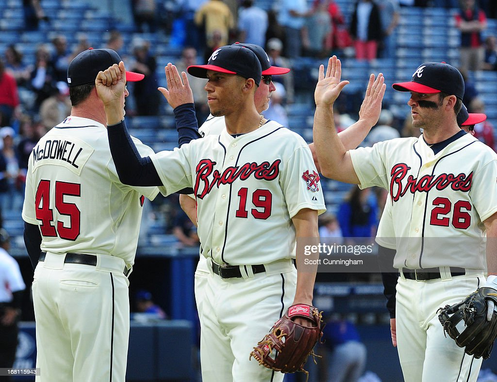 <a gi-track='captionPersonalityLinkClicked' href=/galleries/search?phrase=Andrelton+Simmons&family=editorial&specificpeople=8978424 ng-click='$event.stopPropagation()'>Andrelton Simmons</a> #19 and <a gi-track='captionPersonalityLinkClicked' href=/galleries/search?phrase=Dan+Uggla&family=editorial&specificpeople=542208 ng-click='$event.stopPropagation()'>Dan Uggla</a> #26 of the Atlanta Braves celebrate after the game against the New York Mets at Turner Field on May 5, 2013 in Atlanta, Georgia.