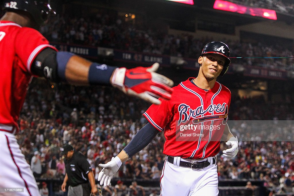 <a gi-track='captionPersonalityLinkClicked' href=/galleries/search?phrase=Andrelton+Simmons&family=editorial&specificpeople=8978424 ng-click='$event.stopPropagation()'>Andrelton Simmons</a> #19 celebrates with <a gi-track='captionPersonalityLinkClicked' href=/galleries/search?phrase=Jason+Heyward&family=editorial&specificpeople=5043351 ng-click='$event.stopPropagation()'>Jason Heyward</a> #22 of the Atlanta Braves after a solo home run in the fifth inning against the Arizona Diamondbacks at Turner Field on June 28, 2013 in Atlanta, Georgia.