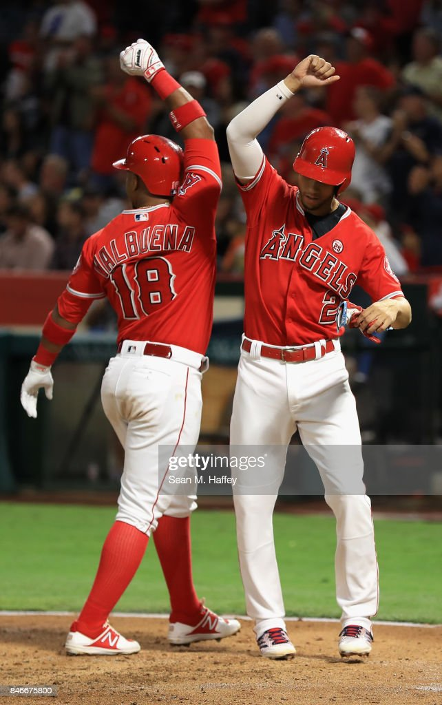 Andrelton Simmons #2 congratulates Luis Valbuena #18 of the Los Angeles Angels of Anaheim after his two-run homerun during the first inning of a game against the Houston Astros at Angel Stadium of Anaheim on September 13, 2017 in Anaheim, California.