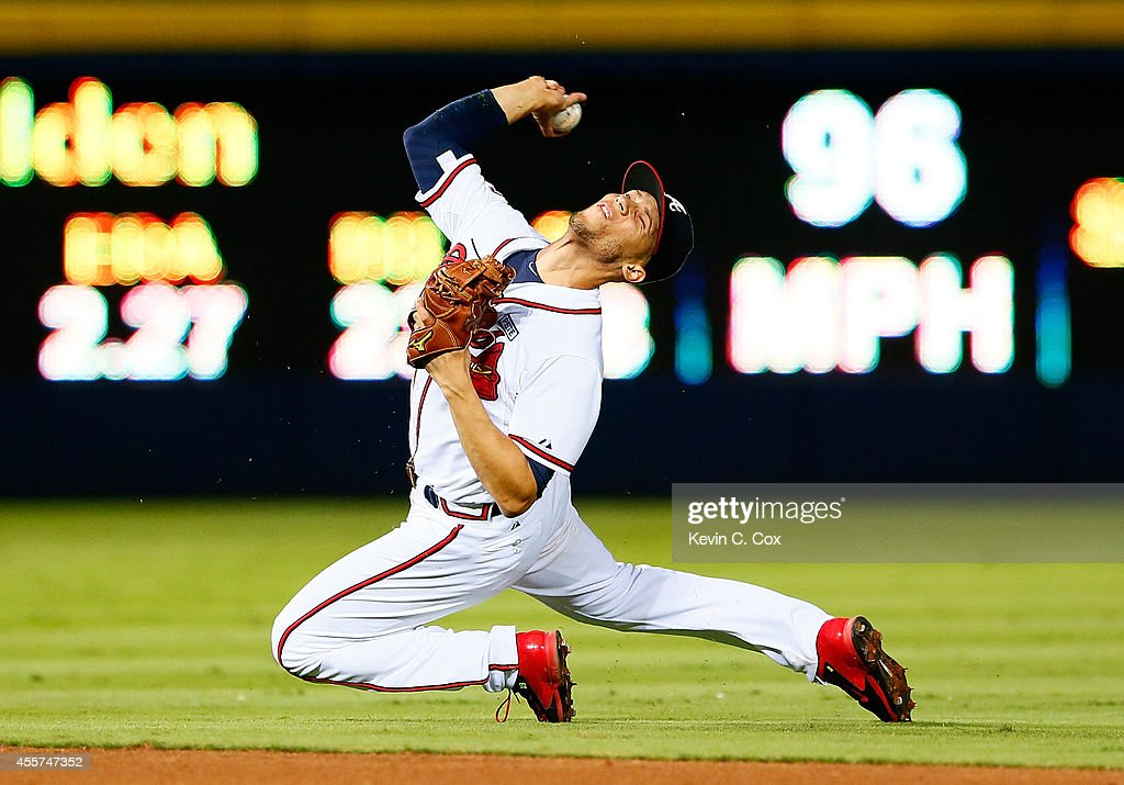 <a gi-track='captionPersonalityLinkClicked' href=/galleries/search?phrase=Andrelton+Simmons&family=editorial&specificpeople=8978424 ng-click='$event.stopPropagation()'>Andrelton Simmons</a> #19 of the Atlanta Braves attempts to make a play on a single hit by Wilmer Flores #4 of the New York Mets in the ninth inning at Turner Field on September 19, 2014 in Atlanta, Georgia.