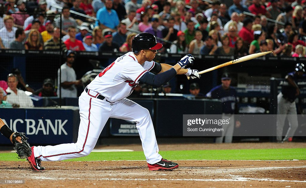 <a gi-track='captionPersonalityLinkClicked' href=/galleries/search?phrase=Andrelton+Simmons&family=editorial&specificpeople=8978424 ng-click='$event.stopPropagation()'>Andrelton Simmons</a> #19 of the Atlanta Braves breaks his bat while hitting against the Colorado Rockies at Turner Field on July 29, 2013 in Atlanta, Georgia.