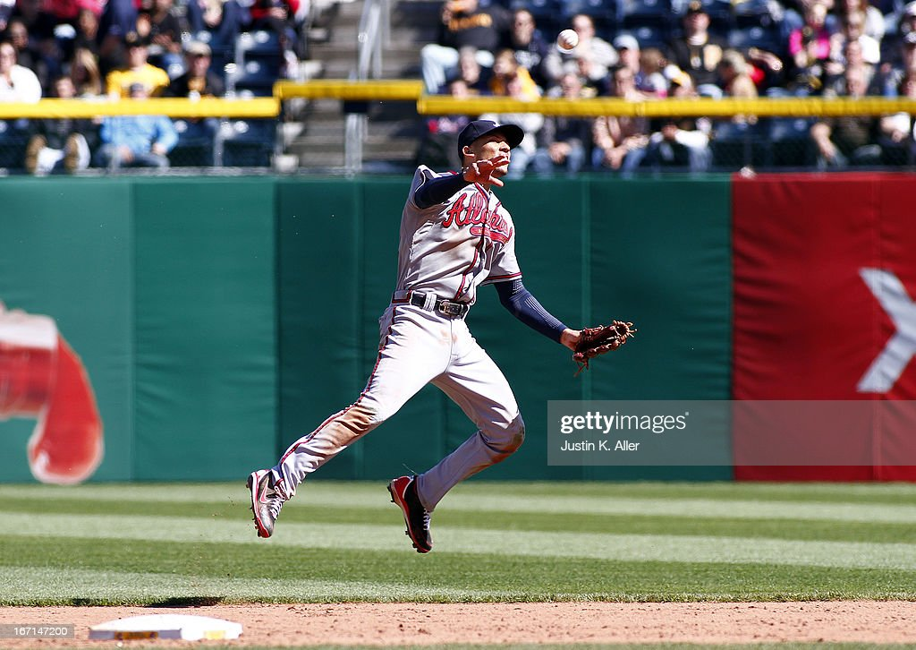 <a gi-track='captionPersonalityLinkClicked' href=/galleries/search?phrase=Andrelton+Simmons&family=editorial&specificpeople=8978424 ng-click='$event.stopPropagation()'>Andrelton Simmons</a> #19 of the Atlanta Braves can't make a throw in time on a <a gi-track='captionPersonalityLinkClicked' href=/galleries/search?phrase=Clint+Barmes&family=editorial&specificpeople=208223 ng-click='$event.stopPropagation()'>Clint Barmes</a> #12 of the Pittsburgh Pirates (not pictured) infield RBI single in the sixth inning during the game on April 21, 2013 at PNC Park in Pittsburgh, Pennsylvania. The Pirates defeated the Braves 4-2.