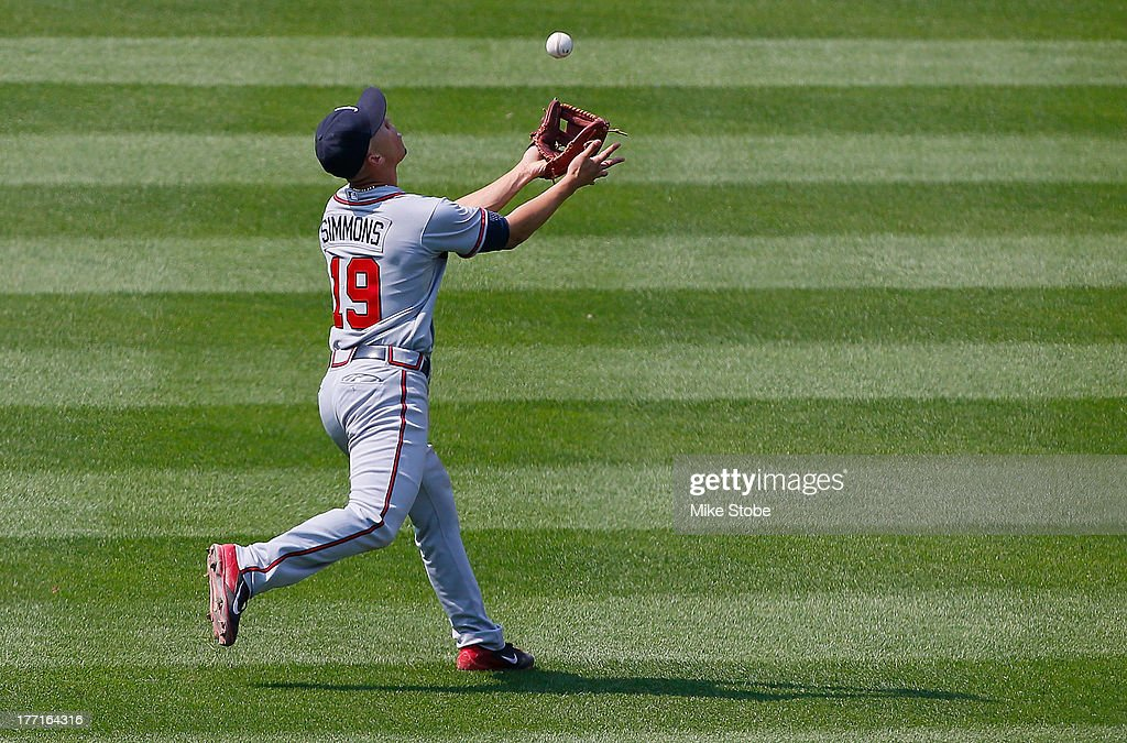<a gi-track='captionPersonalityLinkClicked' href=/galleries/search?phrase=Andrelton+Simmons&family=editorial&specificpeople=8978424 ng-click='$event.stopPropagation()'>Andrelton Simmons</a> #19 of the Atlanta Braves catches a fly ball against the New York Mets at Citi Field on August 21, 2013 at Citi Field in the Flushing neighborhood of the Queens borough of New York City.