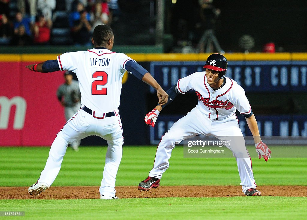 <a gi-track='captionPersonalityLinkClicked' href=/galleries/search?phrase=Andrelton+Simmons&family=editorial&specificpeople=8978424 ng-click='$event.stopPropagation()'>Andrelton Simmons</a> #19 of the Atlanta Braves celebrates with B. J. Upton #2 after knocking in the game-winning run in the 9th inning against the Milwaukee Brewers at Turner Field on September 24, 2013 in Atlanta, Georgia.