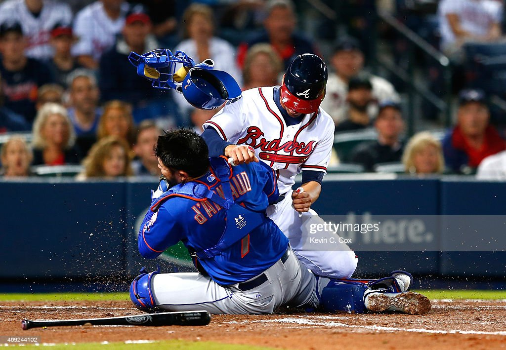<a gi-track='captionPersonalityLinkClicked' href=/galleries/search?phrase=Andrelton+Simmons&family=editorial&specificpeople=8978424 ng-click='$event.stopPropagation()'>Andrelton Simmons</a> #19 of the Atlanta Braves collides with Travis d'Arnaud #7 of the New York Mets as he is tagged out at homeplate in the second inning during the Braves home opener at Turner Field on April 10, 2015 in Atlanta, Georgia.