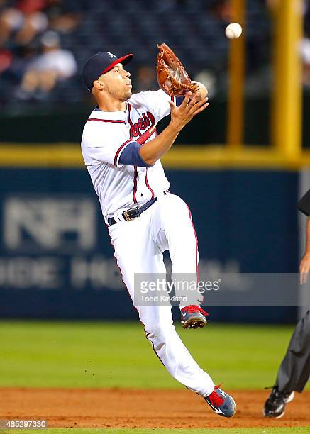 Andrelton Simmons of the Atlanta Braves fields a ball off the bat of Charlie Blackmon of the Colorado Rockies in the seventh inning on August 26 2015...