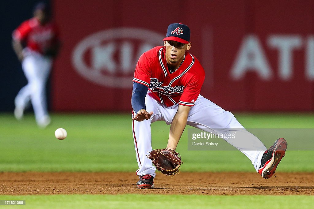 <a gi-track='captionPersonalityLinkClicked' href=/galleries/search?phrase=Andrelton+Simmons&family=editorial&specificpeople=8978424 ng-click='$event.stopPropagation()'>Andrelton Simmons</a> #19 of the Atlanta Braves fields a ground ball in the seventh inning against the Arizona Diamondbacks at Turner Field on June 28, 2013 in Atlanta, Georgia.
