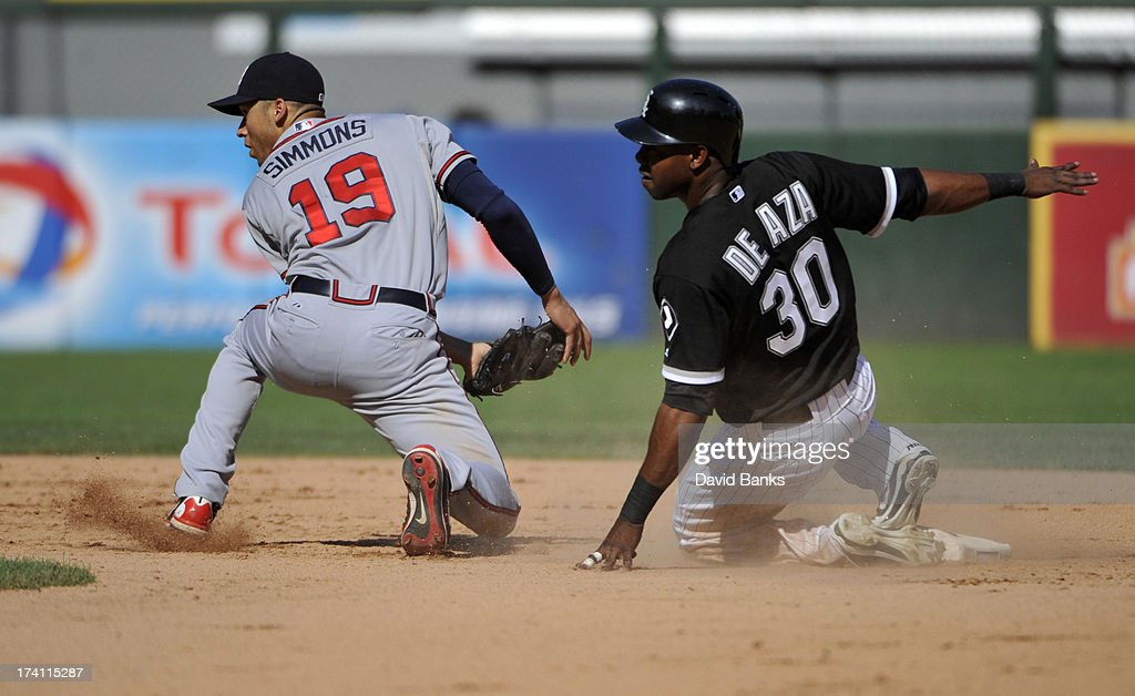 <a gi-track='captionPersonalityLinkClicked' href=/galleries/search?phrase=Andrelton+Simmons&family=editorial&specificpeople=8978424 ng-click='$event.stopPropagation()'>Andrelton Simmons</a> #19 of the Atlanta Braves forces out <a gi-track='captionPersonalityLinkClicked' href=/galleries/search?phrase=Alejandro+De+Aza&family=editorial&specificpeople=4181650 ng-click='$event.stopPropagation()'>Alejandro De Aza</a> #30 of the Chicago White Sox during the fourth inning on July 20, 2013 at U.S. Cellular Field in Chicago, Illinois.
