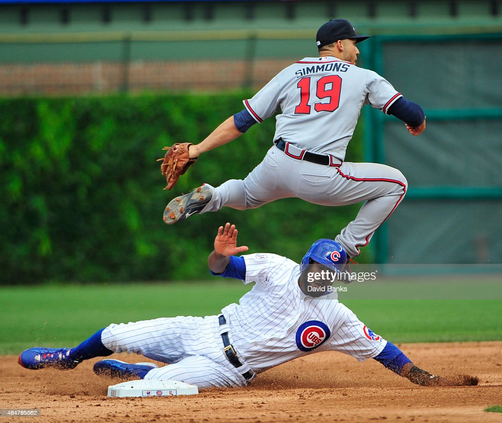 <a gi-track='captionPersonalityLinkClicked' href=/galleries/search?phrase=Andrelton+Simmons&family=editorial&specificpeople=8978424 ng-click='$event.stopPropagation()'>Andrelton Simmons</a> #19 of the Atlanta Braves forces out <a gi-track='captionPersonalityLinkClicked' href=/galleries/search?phrase=Dexter+Fowler&family=editorial&specificpeople=4949024 ng-click='$event.stopPropagation()'>Dexter Fowler</a> #24 of the Chicago Cubs during the fifth inning on August 21, 2015 at Wrigley Field in Chicago, Illinois.