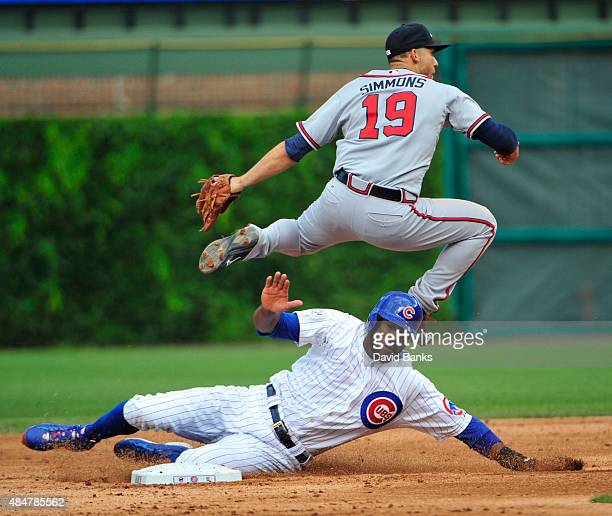 Andrelton Simmons of the Atlanta Braves forces out Dexter Fowler of the Chicago Cubs during the fifth inning on August 21 2015 at Wrigley Field in...
