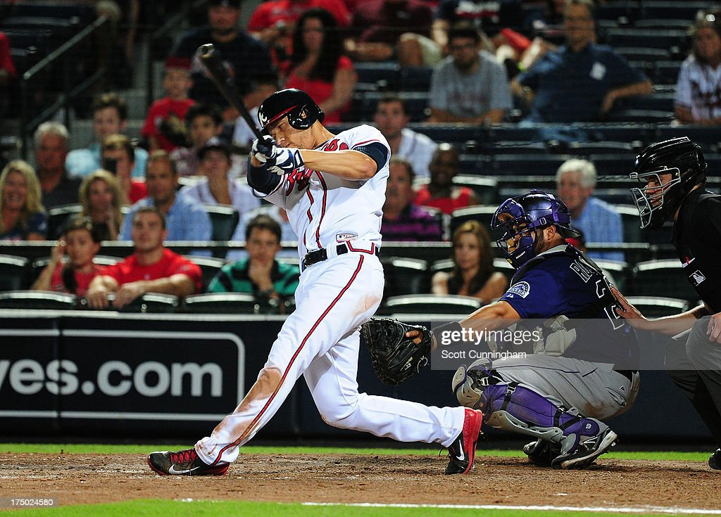 <a gi-track='captionPersonalityLinkClicked' href=/galleries/search?phrase=Andrelton+Simmons&family=editorial&specificpeople=8978424 ng-click='$event.stopPropagation()'>Andrelton Simmons</a> #19 of the Atlanta Braves hits a game-winning triple in the 10th inning against the Colorado Rockies at Turner Field on July 29, 2013 in Atlanta, Georgia.
