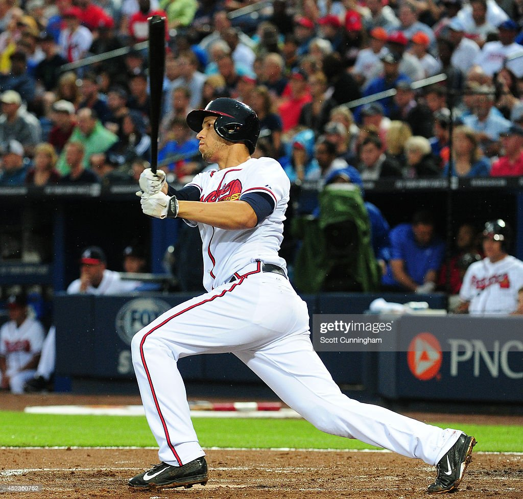 <a gi-track='captionPersonalityLinkClicked' href=/galleries/search?phrase=Andrelton+Simmons&family=editorial&specificpeople=8978424 ng-click='$event.stopPropagation()'>Andrelton Simmons</a> #19 of the Atlanta Braves hits a second inning single to score two runs against the Philadelphia Phillies at Turner Field on July 18, 2014 in Atlanta, Georgia.