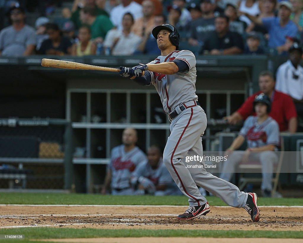 <a gi-track='captionPersonalityLinkClicked' href=/galleries/search?phrase=Andrelton+Simmons&family=editorial&specificpeople=8978424 ng-click='$event.stopPropagation()'>Andrelton Simmons</a> #19 of the Atlanta Braves hits a two-run home run in the 2nd inning against the Chicago White Sox at U.S. Cellular Field on July 19, 2013 in Chicago, Illinois.
