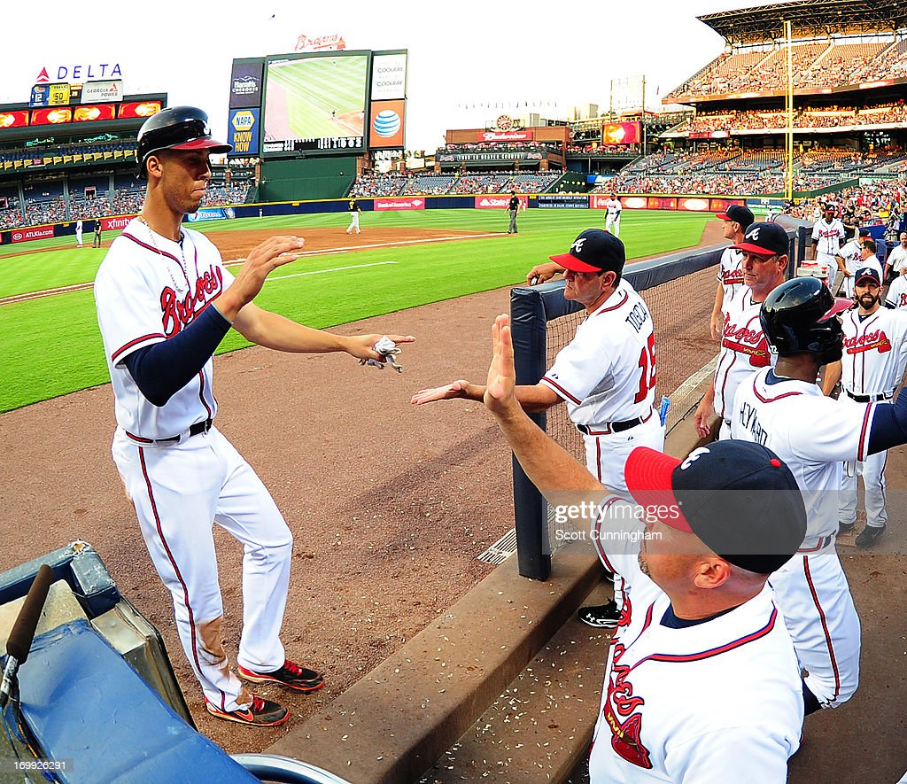 <a gi-track='captionPersonalityLinkClicked' href=/galleries/search?phrase=Andrelton+Simmons&family=editorial&specificpeople=8978424 ng-click='$event.stopPropagation()'>Andrelton Simmons</a> #19 of the Atlanta Braves is congratulated by teammates after scoring a third inning run against the Pittsburgh Pirates at Turner Field on June 4, 2013 in Atlanta, Georgia.
