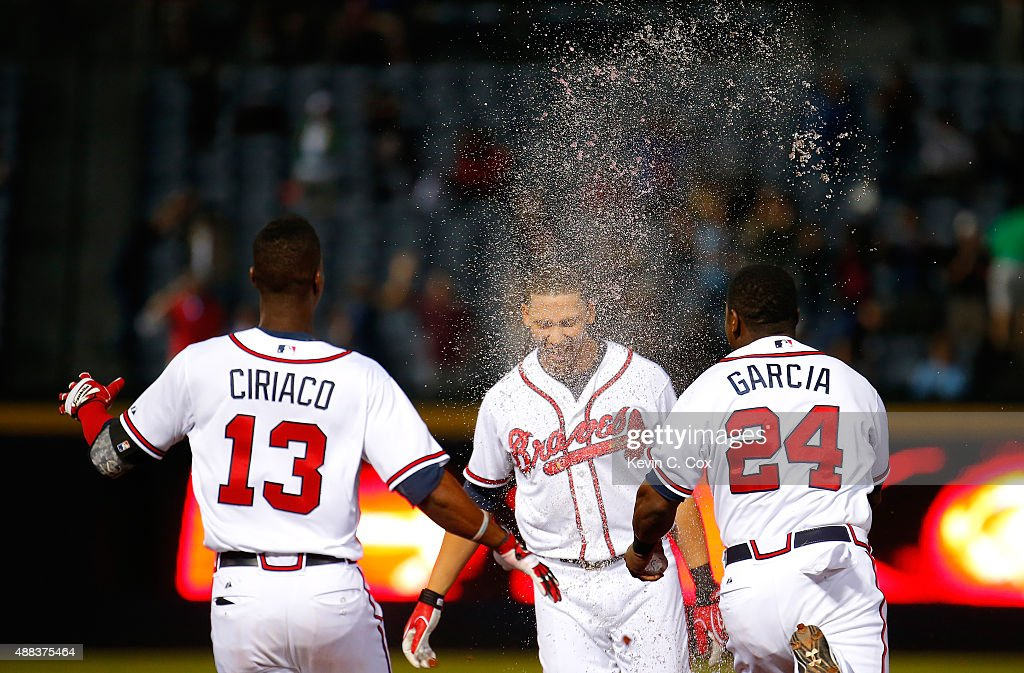 <a gi-track='captionPersonalityLinkClicked' href=/galleries/search?phrase=Andrelton+Simmons&family=editorial&specificpeople=8978424 ng-click='$event.stopPropagation()'>Andrelton Simmons</a> #19 of the Atlanta Braves is doused with liquid after hitting a walk-off RBI single in the ninth inning against the Toronto Blue Jays at Turner Field on September 15, 2015 in Atlanta, Georgia.