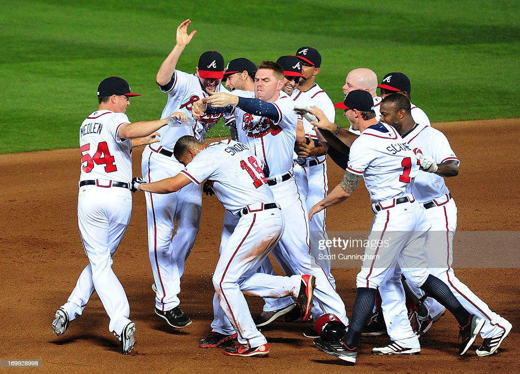 <a gi-track='captionPersonalityLinkClicked' href=/galleries/search?phrase=Andrelton+Simmons&family=editorial&specificpeople=8978424 ng-click='$event.stopPropagation()'>Andrelton Simmons</a> #19 of the Atlanta Braves is mobbed by teammates after knocking in the game-winning run in the 10th inning against the Pittsburgh Pirates at Turner Field on June 4, 2013 in Atlanta, Georgia.